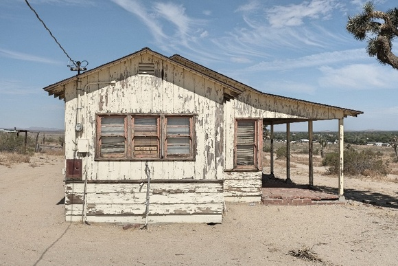 Hunting cabin from 1940's surrounded by Joshua trees and next to a main road which gives easy access to the cabin. The property has 24000 sq. ft. of parking space. The student rate is up to 15 people. The Indie rate is up to 30 people. Larger crews pay a higher rate. Bring your own generator.