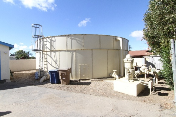 Water tanks, rock area, small building. Two Parcels - Each about 10000 square feet.