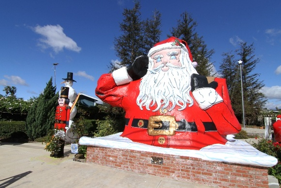 Gated Large Santa Statue, Sleigh, and Rudolph, Snowman, Nutcracker Statues. Garden Area.