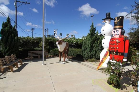 Gated Large Santa Statue, Sleigh, and Rudolph, Snowman, Nutcracker Statues. Garden Area.