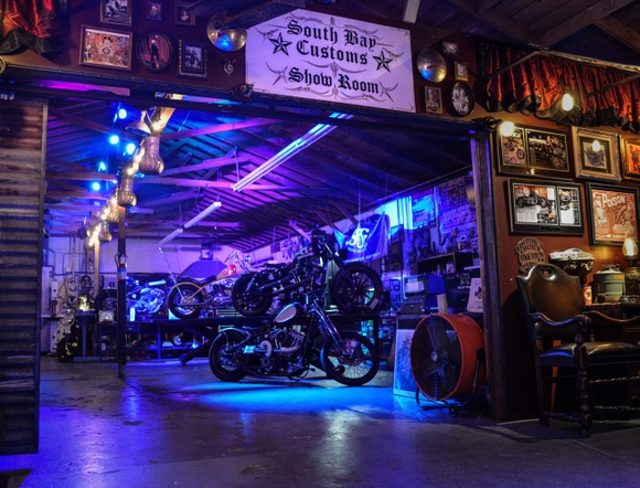 Eclectic converted warehouse in the style of an old Hollywood club meets New Orleans with turn-key stage for live performance, full kitchen, attached custom motorcycle fabrication shop, outdoor ground level patio and small rooftop deck.