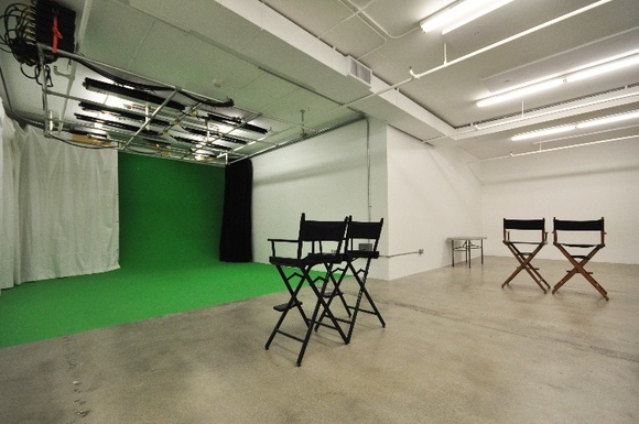 Rental includes pre-lit green screen, white and grey seamless, lighting and grip gear, dressing room and makeup room. You also have access to a Cafe Space, Kitchen, Zen room for breaks (maximum of 10 person crew). Green Screen is 17 by 12 feet in a 1000 sq ft space. There is enough space if you need to set up another backdrop as well. Located on 11th floor. The freight elevator is available during business hours. Rentals are available mostly during business hours. Business hours: Mon-Fri 9AM-5PM. The studio can accommodate weekends for commercial shoots over 6 hours and student and indie productions over 12 hours.