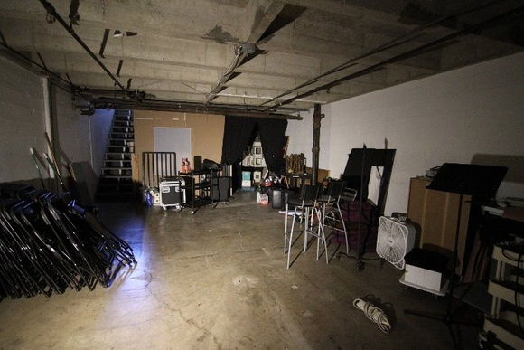 Basement is industrial with white brick walls and low ceilings. Only small, quiet shoots are allowed after 10PM. Small storage space in the basement is not available.