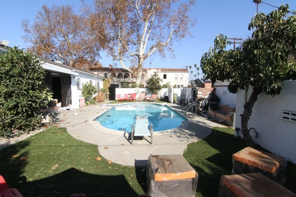 Pool Area of a Spanish Style Duplex with Lounge Chairs and a small Patio. Right now all the furniture is cleared out for the winter, but we can always put it back. A separate Concrete Yard. Student productions might get a discount depending on the number of hours.
