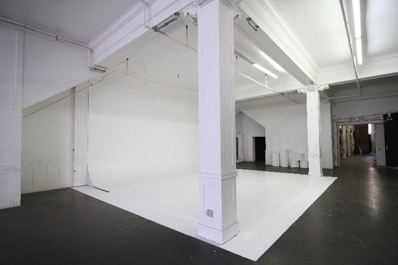 We are a large finished warehouse with several different atmospheres. First Floor includes two different basement spaces. Second Floor includes a studio with a white cyclorama, makeup room, restrooms, a standing set room,  warehouse type space with brick walls, bar set, and a staircase to the upstairs loft, which can be used as an office, production office or a staging area. There is an elevator between the two main floors. Outside area and alley can also be used upon negotiation. For crews higher than 40 people total the rate will be negotiable.