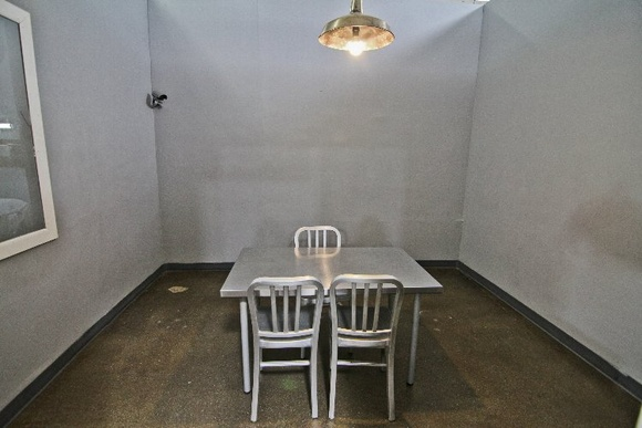 Jail Cells and Interrogation Room                                                                                                 Price includes:                                                                                                  2 bathrooms. Air conditioning and heat. 140 amp dedicated power (20A Circuits) Free Wi-Fi. Garage and Side Loading Doors, Green Room with Kitchen, Make-up and wardrobe room, furniture and props, Free Grip Gear Usage and Lighting Kit.                                                                                                                                                                                                                                                                                                                       Also price includes standing sets below:  https://www.locations.film/location/673                       https://www.locations.film/location/675                       https://www.locations.film/location/677                       https://www.locations.film/location/678                       https://www.locations.film/location/679                       https://www.locations.film/location/680