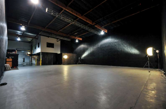 Production Rental facility.  Sound proof, 20 ft. ceilings, 200 amps, stage lights, elephant doors, projector and sound system, flats for set building, 28x28 wooden dance floor, portable outside generator.  2 Floors. All rooms can be used, except office.