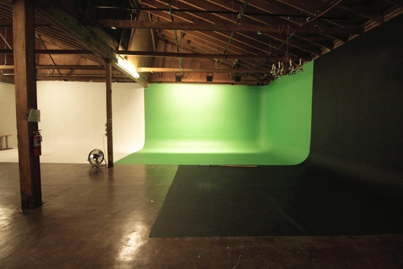 Studio located in a film friendly neighborhood. Available for rental 24/7 and is ideal for film shoots, photography, broadcast multi-camera interviews, TV, commercial content, music videos, promos and web presentations. The screen is pre-lit, and various movable floor lights are available, as well as other equipment and props. 200 amps house power. Studio, Kitchen, Office, Restroom.