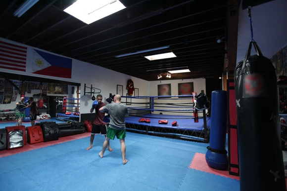 Boxing Gym with full size training ring and full equipment. Rooms: gym, dressing room, patio area. Business hours: Mon-Fri (8AM to 9PM), Sat (8AM to 4PM). Shooting only during off hours and non-scheduled.