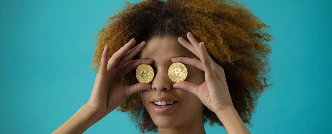 woman holding coins over eyes