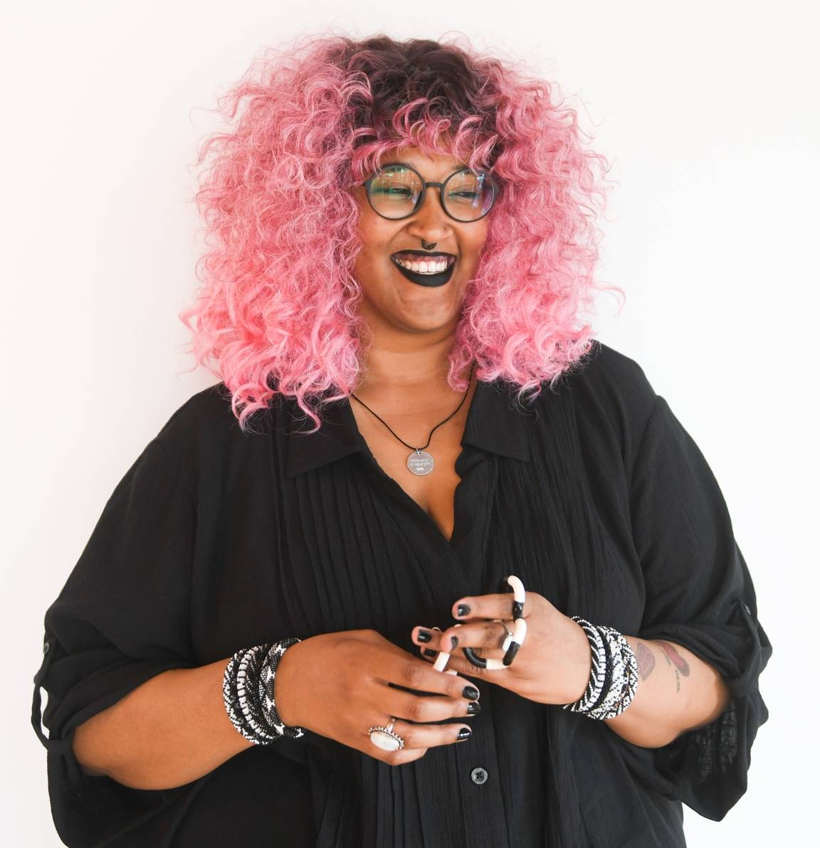 Woman with pink hair smiling