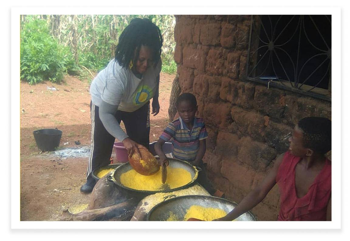 Leontine Sinda, an idealist and humanitarian in Cameroon, teaching the youth to make gari.