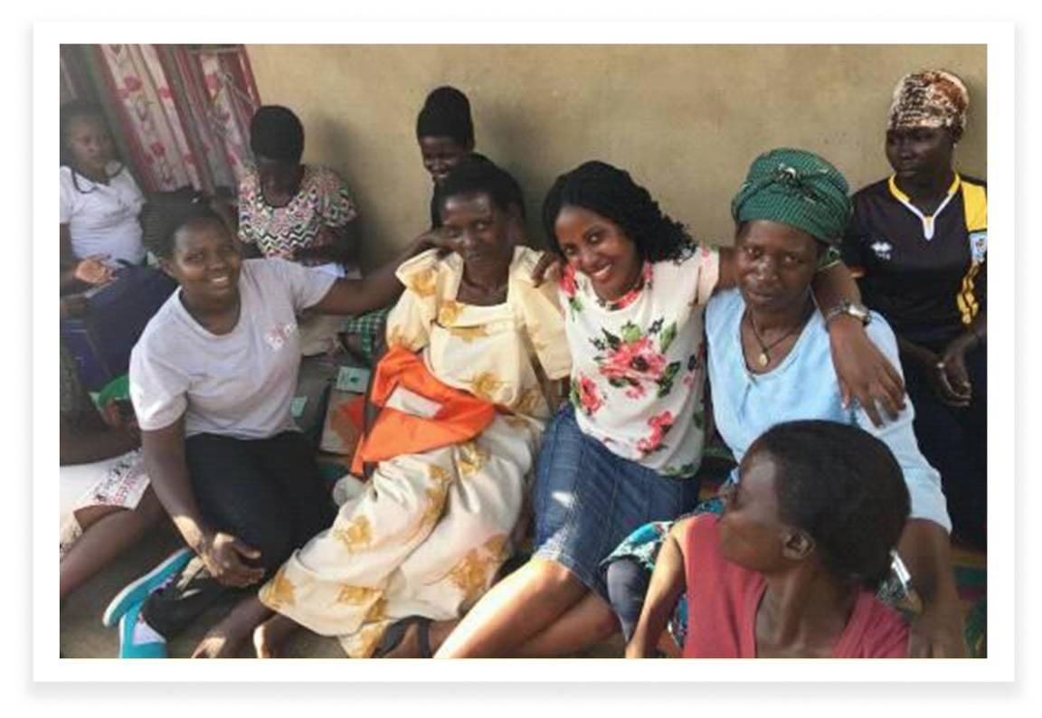 Olivia Namukwaya and Agnes Kirabo with Caretakers at the Orphanage