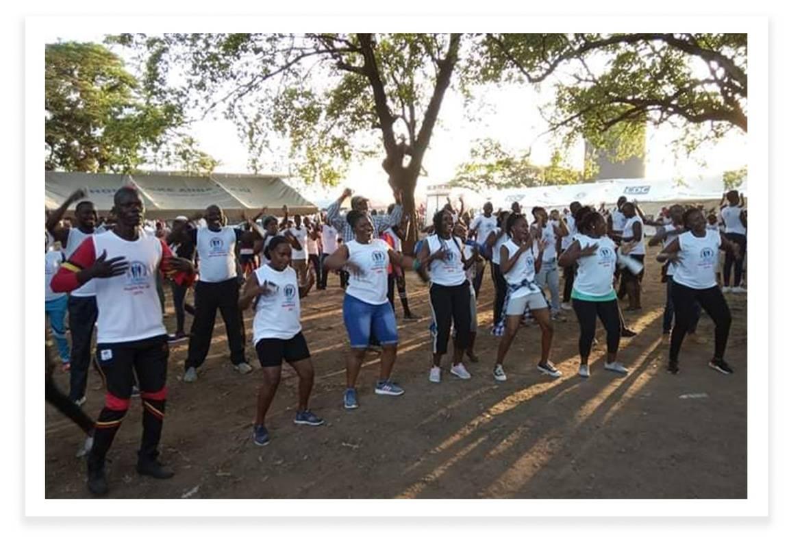 Runners Dancing and Celebrating at the Marathon for Safe Motherhood in Uganda - Idealist Days Blog