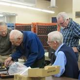 Four experienced volunteers work to solve why a machine malfunctioned.