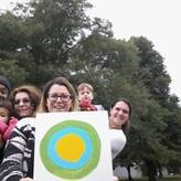 Group outside holding the Idealist logo