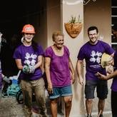 Volunteers on a build site with homeowner