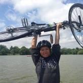 Teng holding up their bike at Como