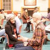 Participants engaging in one-on-one dialogue at Dialogue Nights