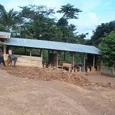 Working with the community to put up a temporary structure for school children in Ghana