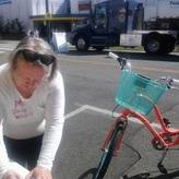 Sally helps fill out a tag for bike parking at an event