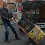 volunteer delivering food on dolly