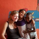 Volunteer smiling with Children