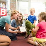 Kids playing and reading with librarians at storytime