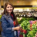 Volunteer grocery shopper picking produce
