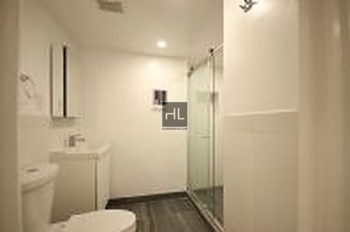 four bedroom apartment features a living room with wall to wall ...